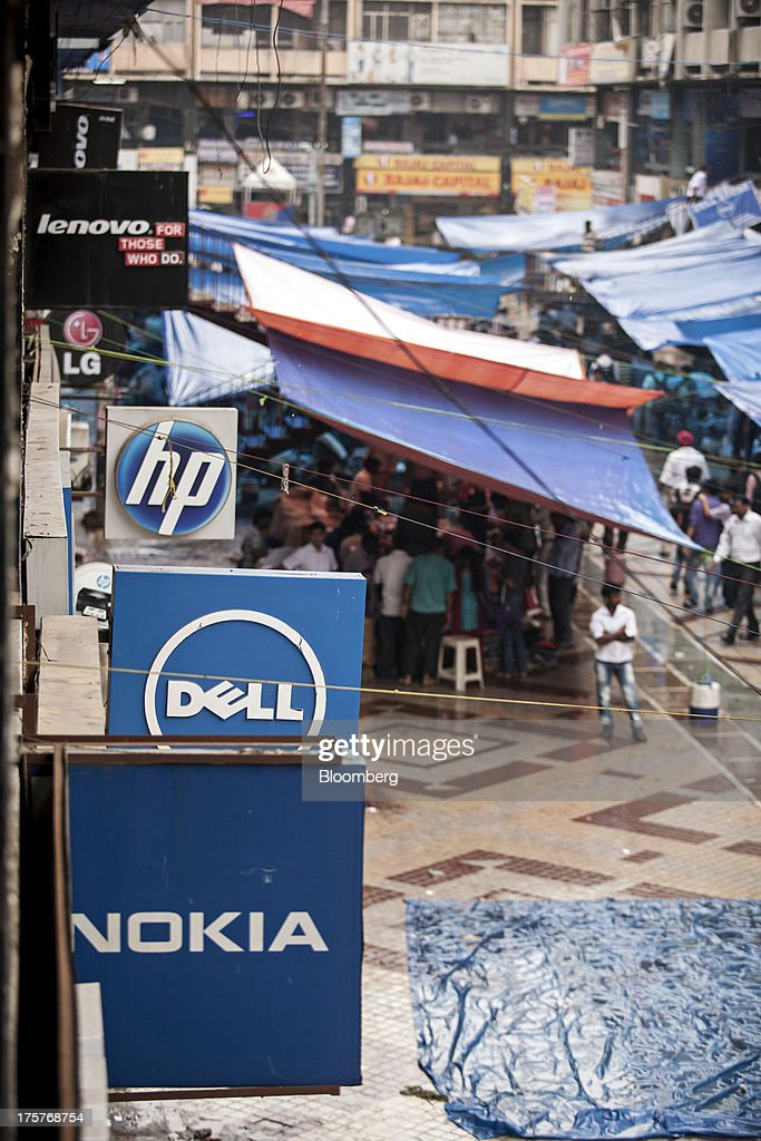 Signage for Nokia Oyj, Dell Inc., Hewlett-Packard Co. and Lenovo Group Ltd. are displayed in Nehru Place IT Market, a hub for the sale of electronic goods and computer accessories, in New Delhi, India, on Wednesday, Aug. 7, 2013. India's consumer price index (CPI) figures for July are scheduled to be released on August 12. Photographer: Graham Crouch/Bloomberg via Getty Images