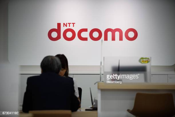 Signage for NTT Docomo Inc is displayed at one of the company's stores in Tokyo Japan on Monday April 24 2017 NTT Docomo one of the world's largest...
