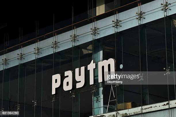 Signage for PayTM a unit of One97 Communications Ltd is displayed at the company's office in Noida Uttar Pradesh India on Wednesday Dec 14 2016...