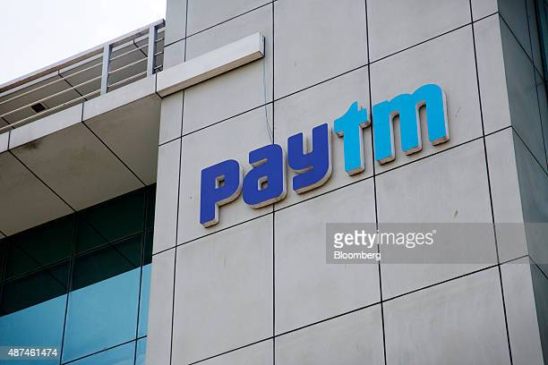 Signage for Paytm is displayed at the One97 Communications Ltd headquarters in Noida Uttar Pradesh India on Thursday May 14 2015 One97 which operates...