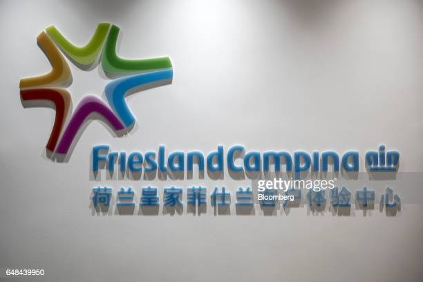 Signage for Royal FrieslandCampina NV is displayed at a training kitchen in Shanghai China on Monday Feb 13 2017 While commonplace in western diets...