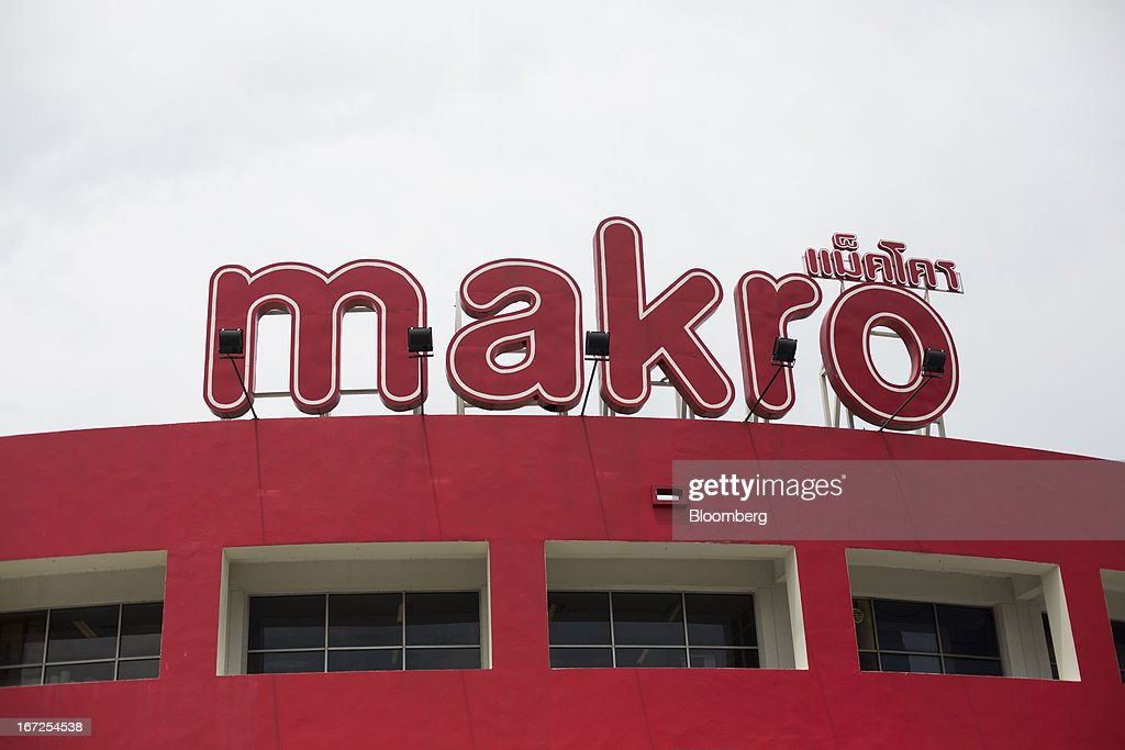 Signage for Siam Makro Pcl is displayed atop one of the company's Makro stores in Bangkok, Thailand, on Tuesday, April 23, 2013. Billionaire Dhanin Chearavanont's CP All Pcl, Thailand's 7-Eleven chain, offered to pay about $6.6 billion for discount retailer Siam Makro Pcl in the biggest takeover announced in Asia this year. Photographer: Brent Lewin/Bloomberg via Getty Images