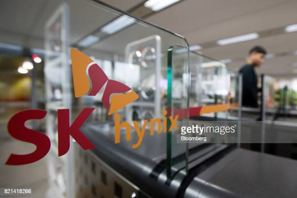 Signage for SK Hynix Inc is displayed on access gates at the entrance to the company's office in Seongnam South Korea on Monday July 24 2017 SK Hynix...