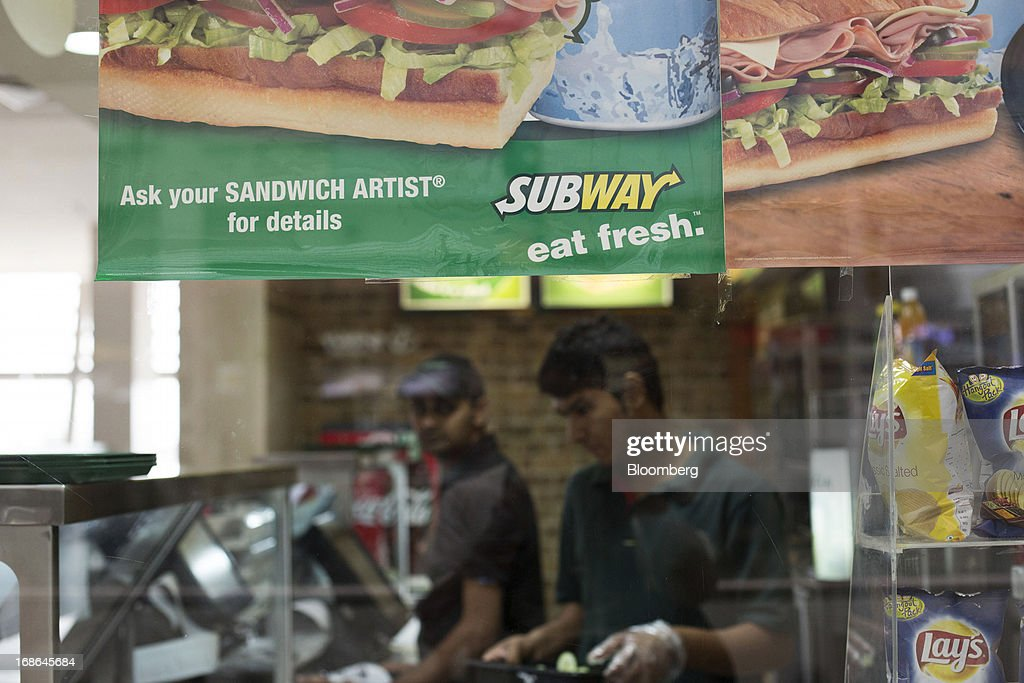 Signage for Subway fast food is displayed at one of the company's restaurants as employees work at the AlphaOne shopping mall in Amritsar, India, on Thursday, May 9, 2013. India's consumer price index (CPI) for April rose 9.39 percent year on year, the Central Statistics Office said in a statement on its website. Photographer: Brent Lewin/Bloomberg via Getty Images