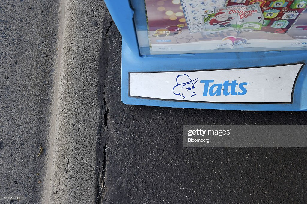 Signage for Tatts Group Ltd. is displayed on a roadside stand outside a newsagent's store in Melbourne, Australia, on Thursday, Dec. 15, 2016. A consortium including Morgan Stanley and KKR & Co. offered as much as A$7.3 billion ($5.5 billion) for Australian betting and lotteries business Tatts Group, setting up a potential bidding war with Tabcorp Holdings Ltd. Photographer: Carla Gottgens/Bloomberg via Getty Images