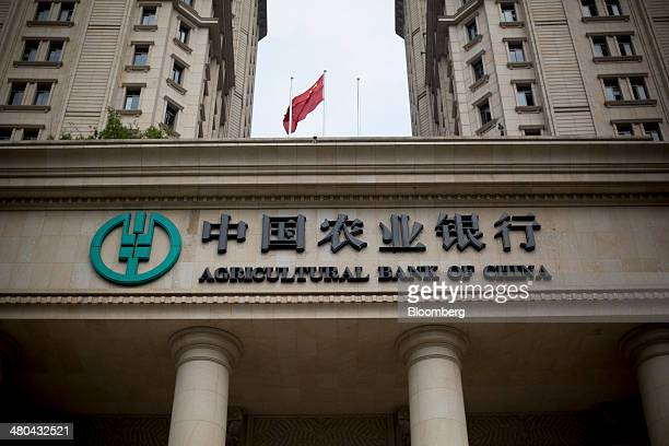 Signage for the Agricultural Bank of China Ltd is displayed at the bank's Guangdong branch in Guangzhou Guangdong Province China on Tuesday March 25...