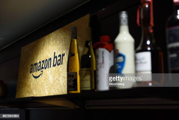 Signage for the Amazon Bar operated by Amazon Japan KK is displayed along with bottles of liquor inside the bar during a media preview in Tokyo Japan...