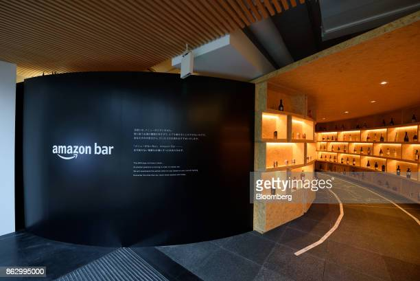 Signage for the Amazon Bar operated by Amazon Japan KK is displayed near the entrance of the bar during a media preview in Tokyo Japan on Thursday...