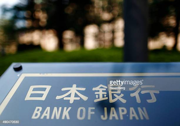Signage for the Bank of Japan is displayed outside the central bank's headquarters in Tokyo Japan on Monday Sept 28 2015 Prime Minister Shinzo Abe's...