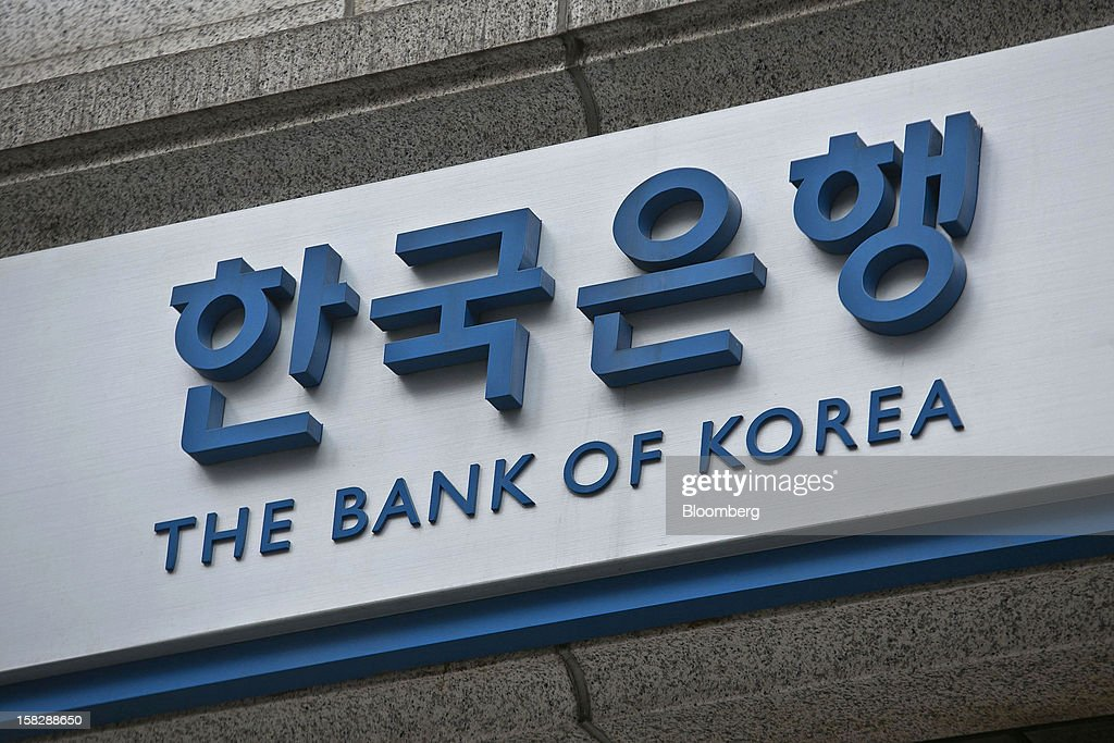 Signage for the Bank of Korea is displayed at the central bank's headquarters in Seoul, South Korea, on Thursday, Dec. 13, 2012. The Bank of Korea held borrowing costs unchanged before next week's presidential election and after North Korea launched a rocket in defiance of international sanctions yesterday. Photographer: Jean Chung/Bloomberg via Getty Images