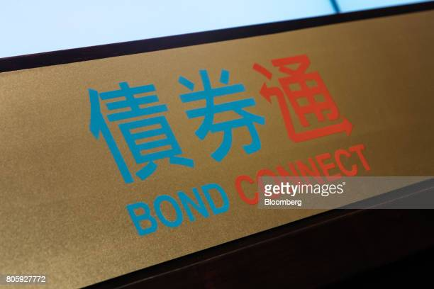 Signage for the ChinaHong Kong Bond Connect is seen at the Hong Kong Stock Exchange in Hong Kong China on Monday July 3 2017 The first day of Chinas...