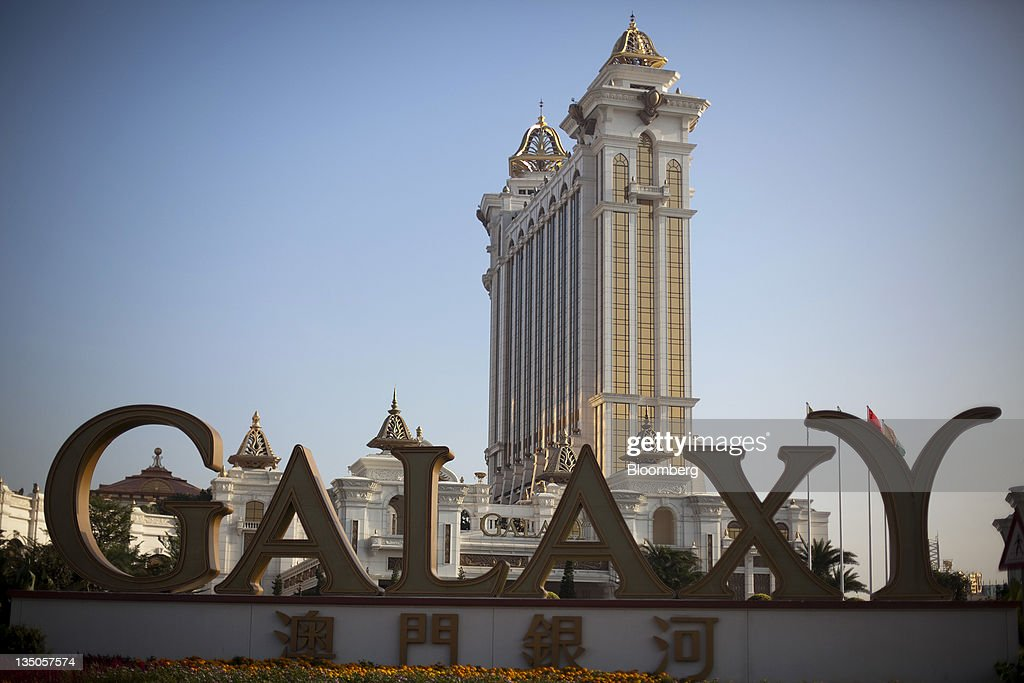 Signage for the Galaxy Macau casino resort is displayed outside the resort in Macau, China, on Sunday, Dec. 4, 2011. Macau casino gambling revenue climbed a better-than-expected 33 percent last month as economic growth stoked demand from visitors from China's mainland. Photographer: Jerome Favre/Bloomberg via Getty Images
