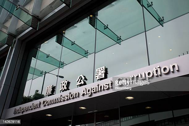 Signage for the Hong Kong Independent Commission Against Corruption is displayed outside the commission's headquarters in Hong Kong China on Tuesday...