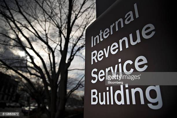 Signage for the Internal Revenue Service stands outside the IRS headquarters building in Washington DC US on Wednesday Feb 17 2016 Taxpayers have...