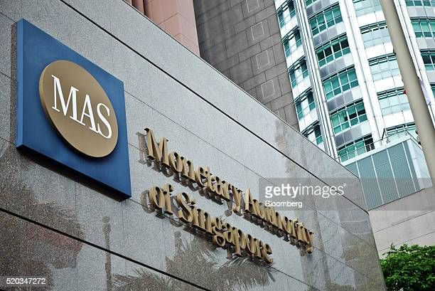 Signage for the Monetary Authority of Singapore is displayed outside the central bank's headquarters in Singapore on Saturday April 9 2016 The...