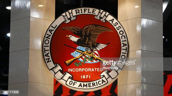 Signage for the National Rifle Association is displayed during the organization's Annual Meetings Exhibits at the George R Brown Convention Center in...