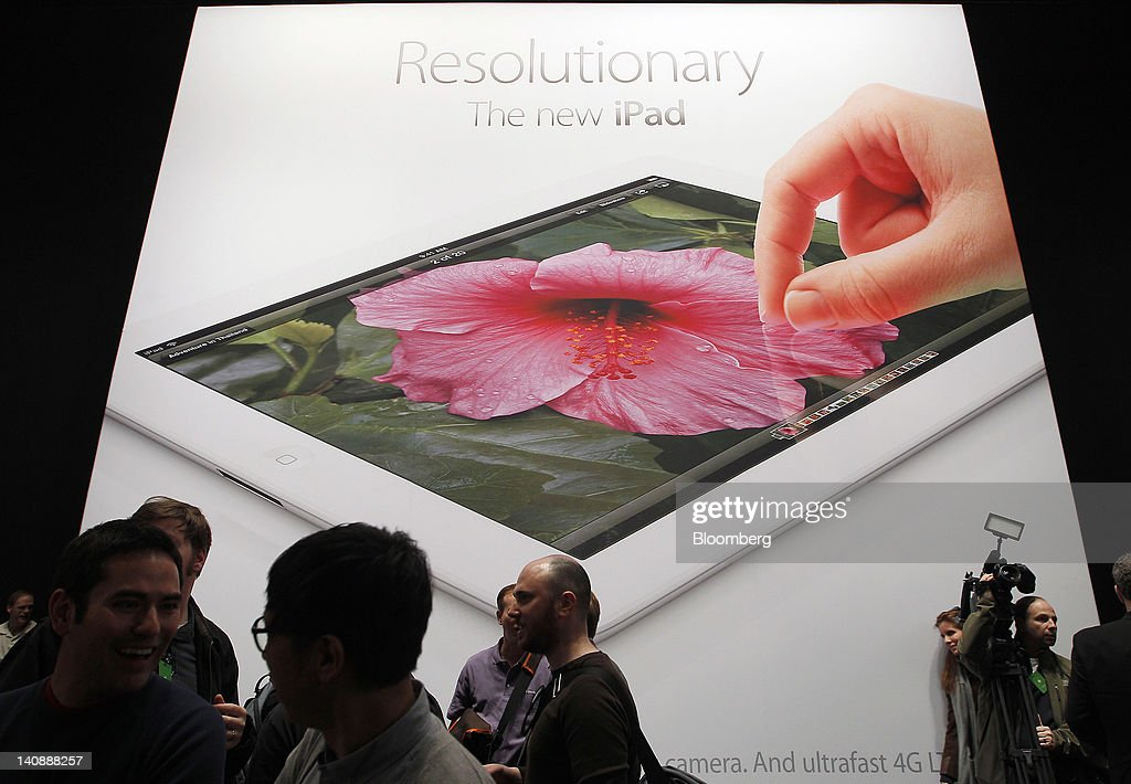 Signage for the new version of Apple Inc.'s iPad table computer is displayed during an Apple event in San Francisco, California, U.S., on Wednesday, March 7, 2012. Apple Inc. introduced a new version of the iPad, beefing up its two-year-old mobile computer with a sharper screen to widen its lead over Amazon.com Inc., Microsoft Corp. and Google Inc. in the tablet market. Photographer: Tony Avelar/Bloomberg via Getty Images