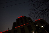 Signage for the Reserve Bank of India is illuminated at night in the BBD Bagh area of Kolkata India on Tuesday Feb 19 2013 India's slowest economic...