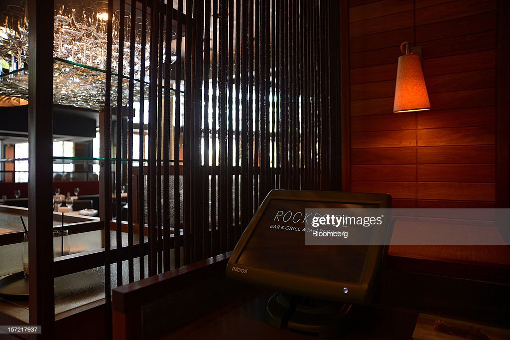 Signage for the Rockpool Bar and Grill is displayed on a waiter's console at the restaurant in Melbourne, Australia, on Wednesday, Nov. 28, 2012. The Australian Bureau of Statistics is expected to release November inflation data on Dec. 3. Photographer: Carla Gottgens/Bloomberg via Getty Images