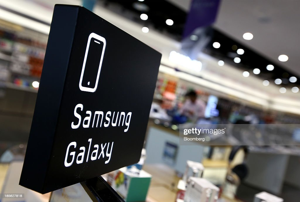 Signage for the Samsung Electronics Co. Galaxy line of devices is displayed at the company's digital plaza store in the Gangnam district in Seoul, South Korea, on Tuesday, Oct. 22, 2013. Samsung Electronics is scheduled to release third-quarter earnings on Oct. 25. Photographer: SeongJoon Cho/Bloomberg via Getty Images