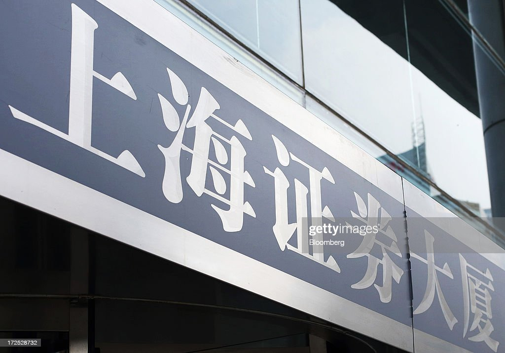 Signage for the Shanghai Stock Exchange Building is displayed at the entrance to the building in Shanghai, China, on Monday, July 1, 2013. Chinese banks' valuations are close to their lowest on record as the nation's interbank funding crisis exacerbated investors' concern that earnings growth will stall and defaults may surge as the economy slows. Photographer: Tomohiro Ohsumi/Bloomberg via Getty Images