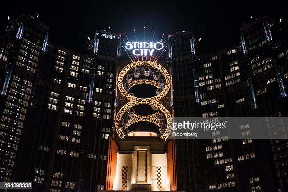 Signage for the Studio City casino resort is illuminated atop the resort developed by Melco Crown Entertainment Ltd at night in Macau China on Monday...