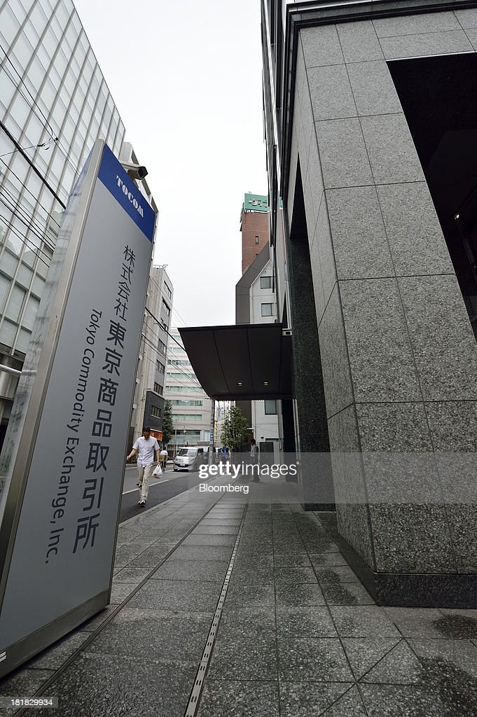 Signage for the Tokyo Commodity Exchange Inc. (Tocom) stands outside the building housing the bourse in Tokyo, Japan, on Wednesday, Sept. 25, 2013. Tokyo Commodity Exchange, Japan's biggest raw materials bourse, plans to attract more trading from investors in China and India to boost volume that's peaking as the yen's slide stalls near 100 to the dollar. Photographer: Akio Kon/Bloomberg via Getty Images