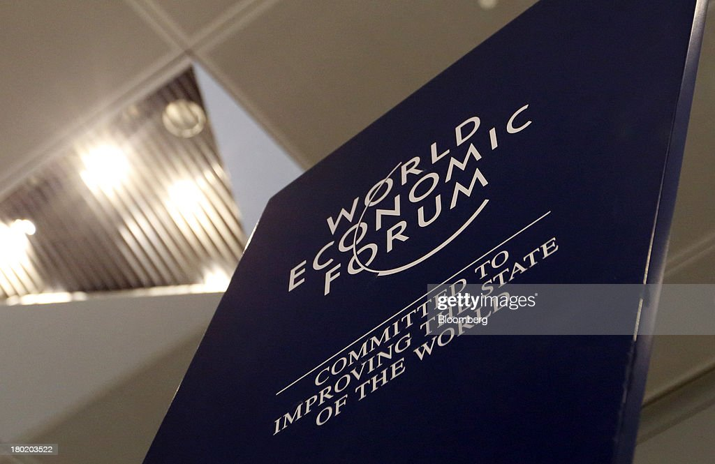 Signage for the World Economic Forum is displayed at the Dalian International Conference Center in Dalian, China, on Tuesday, Sept. 10, 2013. The World Economic Forum Annual Meeting Of The New Champions 2013 will be held in Dalian from Sept. 11 to 13. Photographer: Tomohiro Ohsumi/Bloomberg via Getty Images