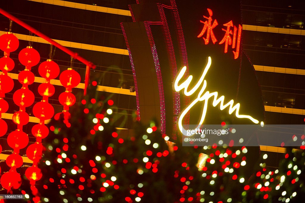 Signage for the Wynn Macau casino resort, operated by Wynn Resorts Ltd., is displayed outside the resort in Macau, China, on Wednesday, Feb. 6, 2013. Casino industry revenue in the gambling hub climbed 14 percent to a record 304 billion patacas ($38 billion) last year. Photographer: Lam Yik Fei/Bloomberg via Getty Images