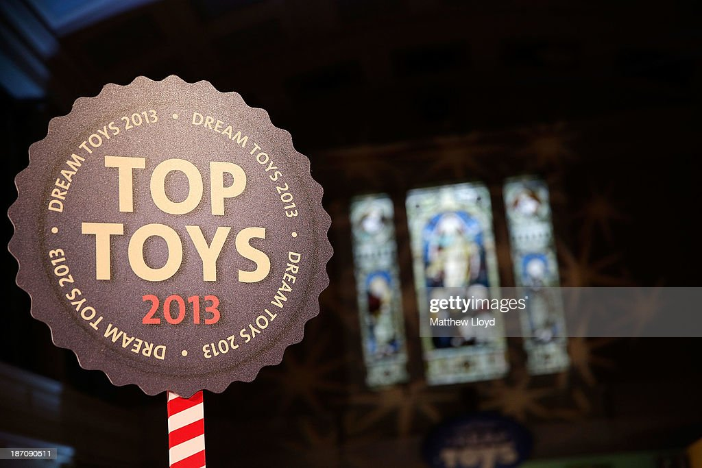 Signage for Top Toys 2013 is displayed at a media event at St Mary's Church in Marylebone on November 6, 2013 in London, England. The Toy Retailers Association's Dream Toys chart, is an independent list of the predicted Christmas top 12 best-selling gifts for children.