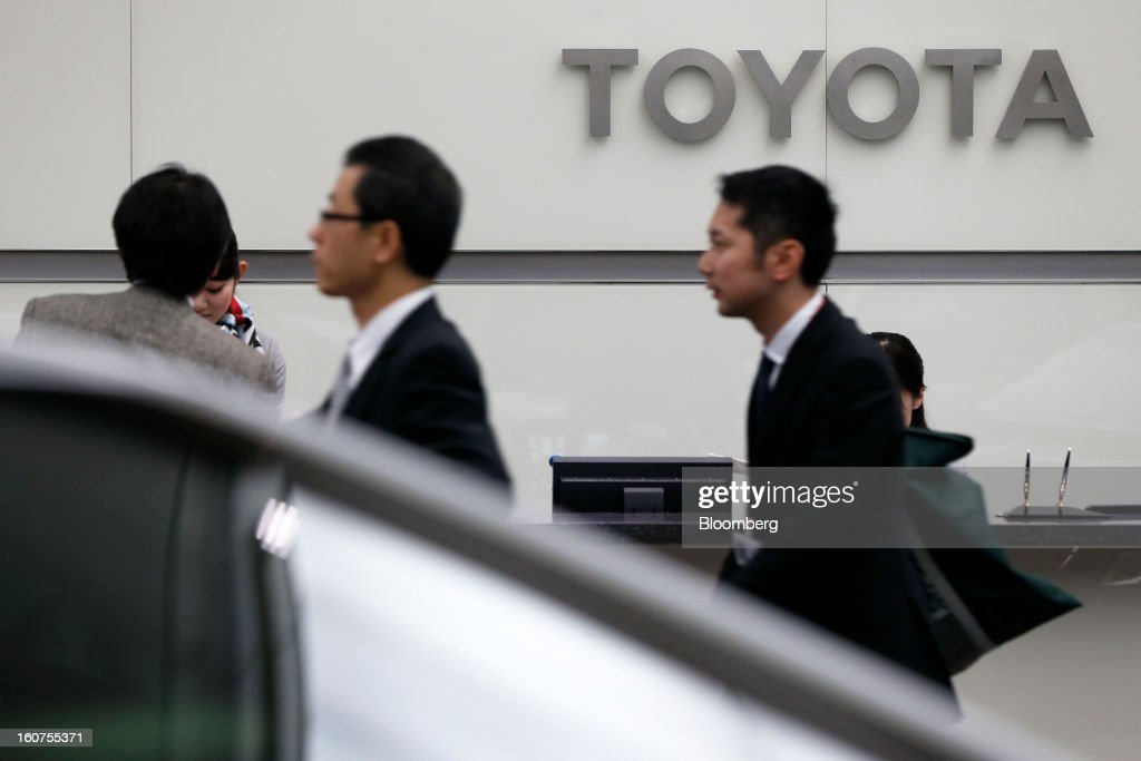 Signage for Toyota Motor Corp. is displayed behind a reception desk at the company's headquarters in Tokyo, Japan, on Tuesday, Feb. 5, 2013. Toyota, the world's biggest carmaker, raised its profit forecast after the yen weakened more than any other currency, raising the value of Japanese cars sold overseas. Photographer: Kiyoshi Ota/Bloomberg via Getty Images