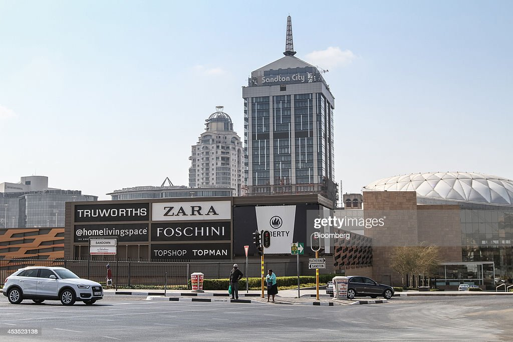Signage for Truworths International Ltd Inditex SA's Zara Foschini Group Ltd and Topshop Ltd fashion brands stands outside the Sandton City shopping...