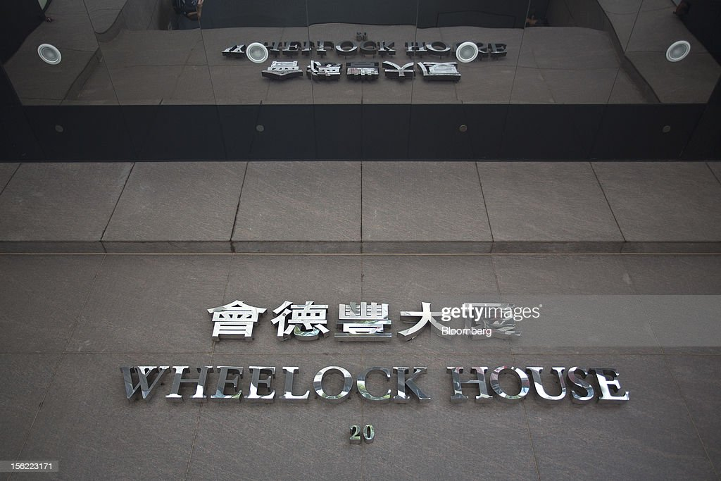 Signage for Wheelock House, which houses the headquarters of Wheelock & Co. Ltd., is displayed at the building's entrance in the Central district of Hong Kong, China, on Saturday, Nov. 10, 2012. Wheelock & Co. is controlled by the family of billionaire Chairman Peter Woo. Photographer: Jerome Favre/Bloomberg via Getty Images
