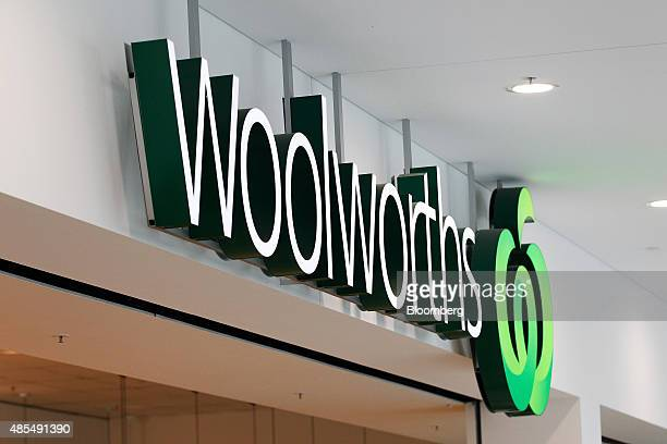 Signage for Woolworths Ltd is displayed atop of one of the company's supermarkets in Sydney Australia on Thursday Aug 27 2015 Woolworths Australias...