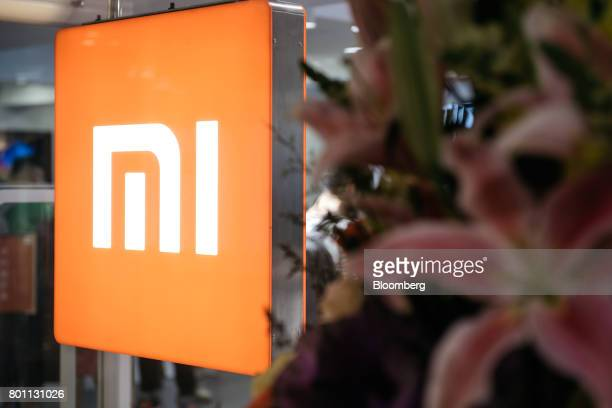 Signage for Xiaomi Corp is illuminated inside one of the company's stores in Hong Kong China on Monday June 26 2017 Smartphone makerXiaomi fifth in...
