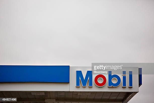 Signage hangs on a canopy at a Exxon Mobil Corp gas station in Rockford Illinois US on Wednesday Oct 28 2015 Exxon Mobil Corp is scheduled to report...