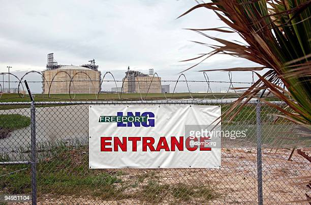 Signage hangs on a fence near to the entrance of the Freeport LNG facility in Quintana Texas US on Wednesday April 1 2009 This facility boasts two...