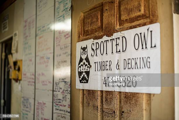 Signage hangs on an office door at the Spotted Owl Timber Inc mill in Santa Fe New Mexico US on Monday Aug 15 2016 Founded in 1991 the family owned...