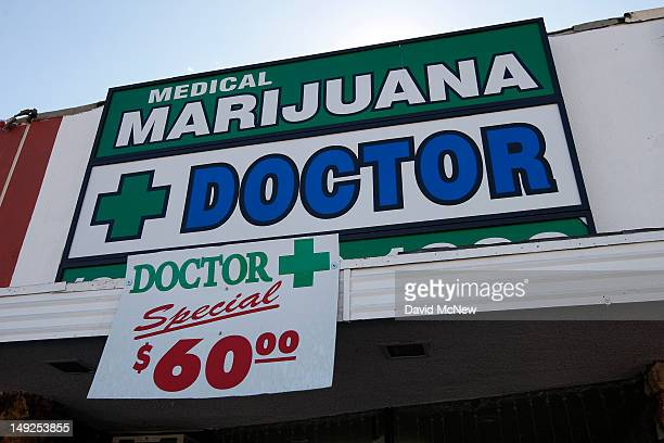 Signage hangs outside Doctor a medical marijuana evaluation clinic which does not distribute marijuana from its facility is seen on July 25 2012 in...