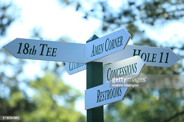 Signage indicates directions to areas such as Amen Corner during a practice round prior to the start of the 2016 Masters Tournament at Augusta...
