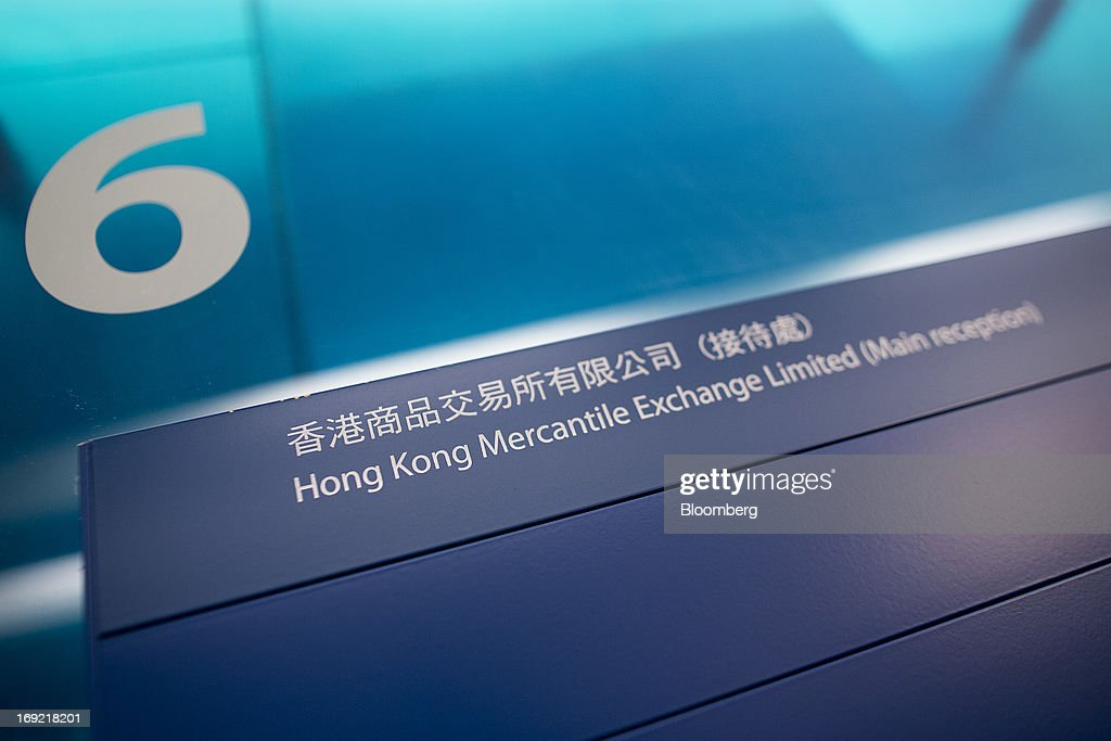 Signage indicating the Hong Kong Mercantile Exchange Ltd. (HKMEx) is displayed in the building that houses the company's offices in Hong Kong, China, on Wednesday, May 22, 2013. Police began probing the Hong Kong Mercantile Exchange, the failed commodities market set up by a member of the city's cabinet, after the securities regulator said it found suspected financial irregularities. Photographer: Jerome Favre/Bloomberg via Getty Images