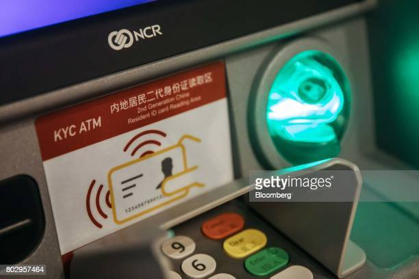 Signage indicating where identification cards can be scanned is displayed on an automated teller machine equipped with facialrecognition software at...