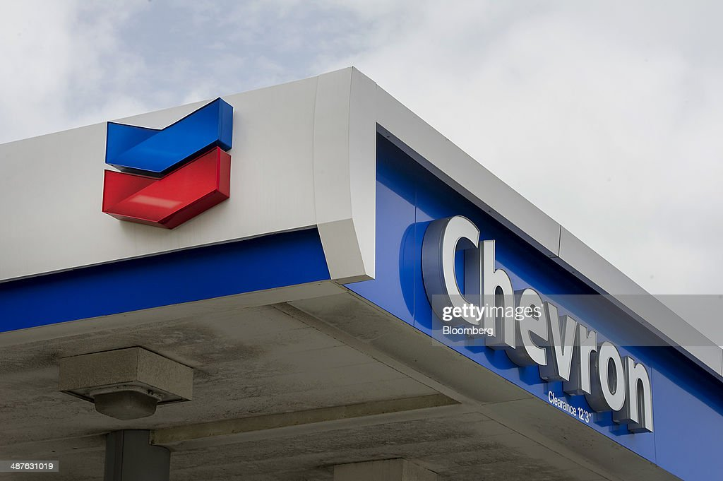 Signage is displayed at a Chevron Corp fueling station in Richmond California US on Thursday April 24 2014 Chevron Corp is expected to release...