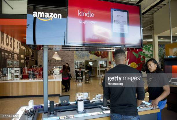 Signage is displayed at an Amazoncom Inc PopUp store inside the Lakeview Whole Foods Market Inc store in Chicago Illinois US on Monday Nov 20 2017...