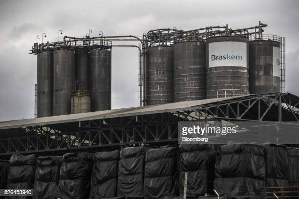 Signage is displayed at the Braskem SA petrochemical plant in Duque de Caxias Brazil on Friday Aug 4 2017 Petroleo Brasileiro SA and Odebrecht SA...