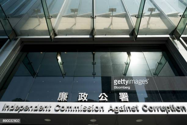 Signage is displayed at the entrance to the Hong Kong Independent Commission Against Corruption headquarters in Hong Kong China on Monday Dec 11 2017...