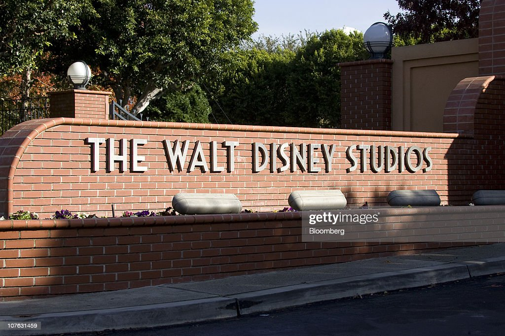 Signage is displayed at the entrance to the Walt Disney Co Studios international headquarters building in Burbank California US on Saturday Dec 11...