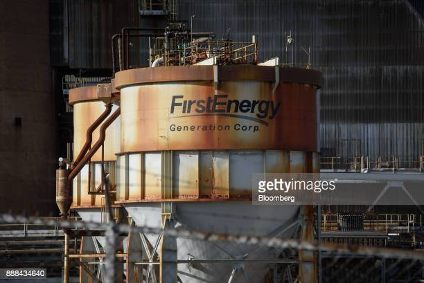 Signage is displayed at the FirstEnergy Corp Bruce Mansfield coalfired power plant in Shippingport Pennsylvania US on Wednesday Dec 6 2017 Across...