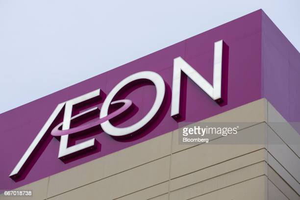 Signage is displayed atop an Aeon shopping mall operated by Aeon Mall Co a unit of Aeon Co in Tokyo Japan on Monday April 10 2017 Aeon Co Japan's...