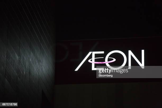 Signage is displayed atop the Aeon shopping mall operated by Aeon Mall Co a unit of Aeon Co in Tokyo Japan on Monday April 10 2017 Aeon Co Japan's...